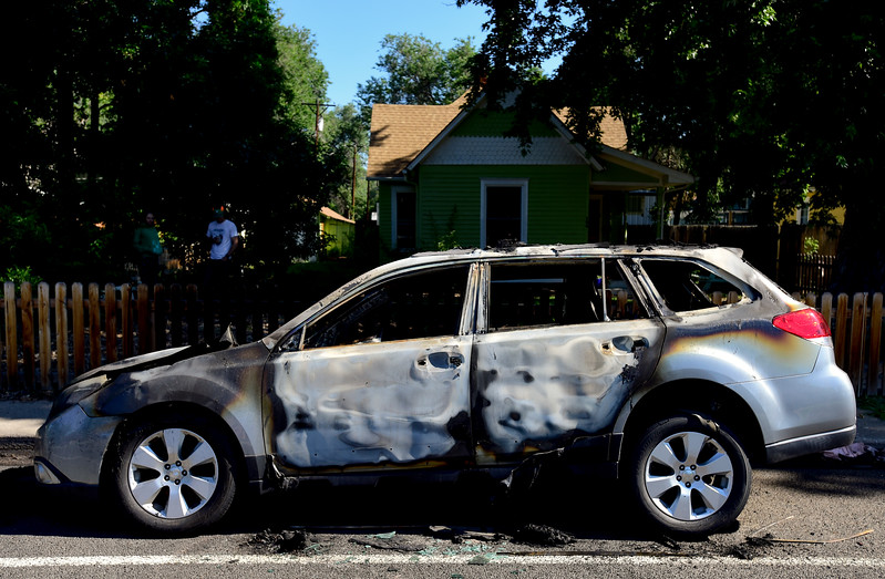 Burned cars are seen on the 100 Block of Longs Peak Avenue in Longmont on Monday. Multiple vehicles were set on fire overnight. More photos: timescall.com. <br /> Matthew Jonas/Staff Photographer June 26,  2017