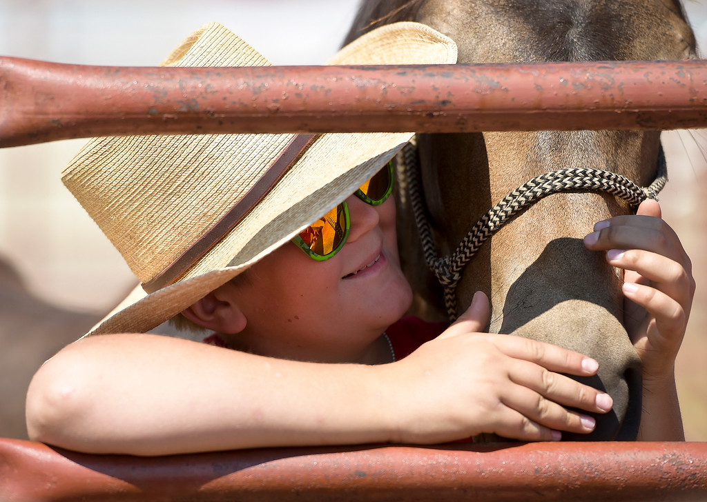 . Spirits of the West 4-H club member Preston Sander-Ferracane, 12, plays with Olive after showing her in the mustang showcase at the Boulder County Fair Tuesday. To view more photos and a video visit timescall.com. Lewis Geyer/Staff Photographer August 01, 2017