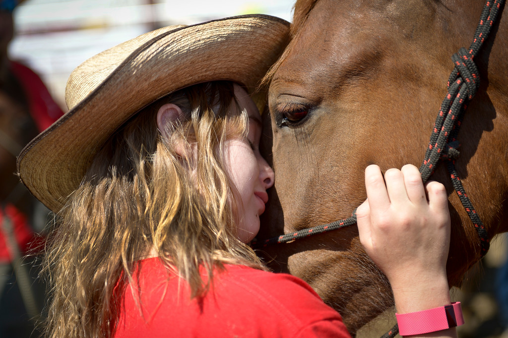 . Spirits of the West 4-H club member Rylah Roberts, 10, hugs Azteca at the Boulder County Fair Tuesday. Roberts has been helping train her mustang since March. To view more photos and a video visit timescall.com. Lewis Geyer/Staff Photographer August 01, 2017