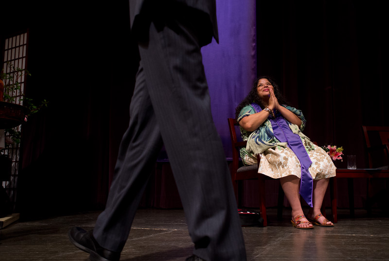 "Guest speaker Brenda Salgado bows her head to a passing graduate on stage during Naropa University's commencement ceremony at Macky Auditorium on Sunday.<br /> More photos:  <a href=""http://www.dailycamera.com"">http://www.dailycamera.com</a><br /> Autumn Parry/Staff Photographer<br /> May 8, 2016"