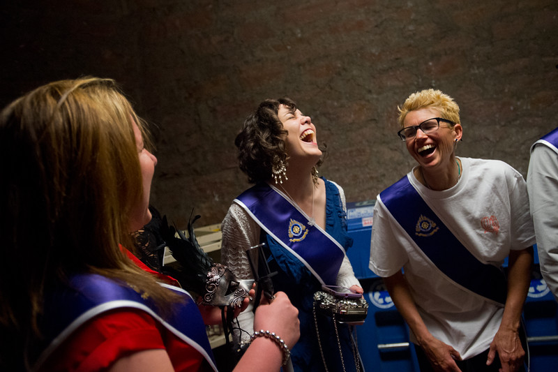 "From left to right, Stephanie Wilbert, Teresa Veramendi and Troy McCall share a laugh while waiting in line for the commencement ceremony to begin for Naropa University at Macky Auditorium in Boulder on Sunday. <br /> More photos:  <a href=""http://www.dailycamera.com"">http://www.dailycamera.com</a><br /> Autumn Parry/Staff Photographer<br /> May 8, 2016"