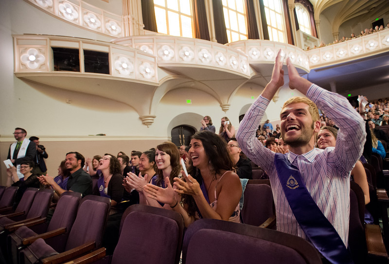 "Ryan Page cheers for graduates as they cross the stage to receive their diploma's during the commencement ceremony for Naropa University at Macky Auditorium in Boulder. <br /> More photos:  <a href=""http://www.dailycamera.com"">http://www.dailycamera.com</a><br /> Autumn Parry/Staff Photographer<br /> May 8, 2016"