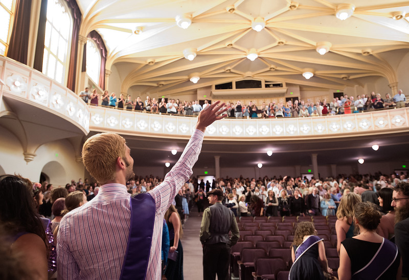 "Ryan Page waves to family and friends in the crowd as students begin to file into Macky Auditorium for Naropa University's commencement ceremony on Sunday.<br /> More photos:  <a href=""http://www.dailycamera.com"">http://www.dailycamera.com</a><br /> Autumn Parry/Staff Photographer<br /> May 8, 2016"