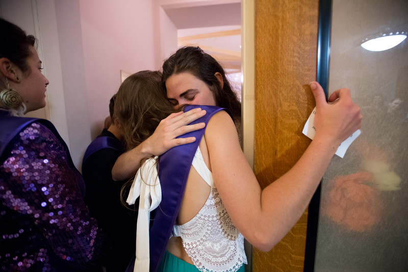 "Lauren Strelau hugs a fellow graduate in the hallway before the commencement ceremony for Naropa University at Macky Auditorium in Boulder on Sunday. <br /> More photos:  <a href=""http://www.dailycamera.com"">http://www.dailycamera.com</a><br /> Autumn Parry/Staff Photographer<br /> May 8, 2016"