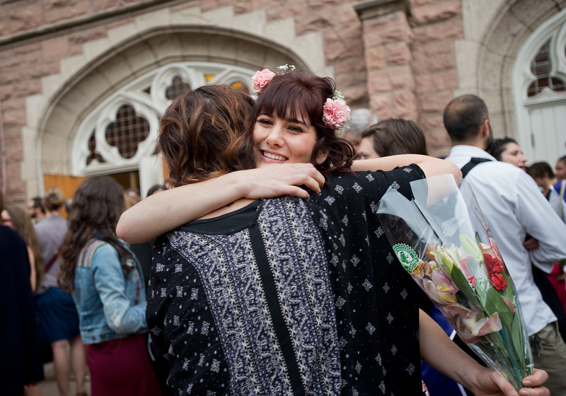 "Molly Kollier receives a hug and flowers after graduating from Naropa University on Sunday.<br /> More photos:  <a href=""http://www.dailycamera.com"">http://www.dailycamera.com</a><br /> Autumn Parry/Staff Photographer<br /> May 8, 2016"