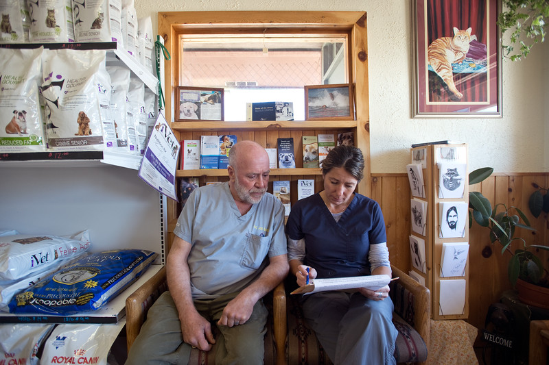 "Dr. Joe Evans reviews a cat's medical history with Dani Dillon, a practice manager, before meeting with Nathan Warner and his cat Ember during a check-up at Nederland Veterinary Hospital. <br /> More photos:  <a href=""http://www.dailycamera.com"">http://www.dailycamera.com</a><br /> (Autumn Parry/Staff Photographer)<br /> May 13, 2016"