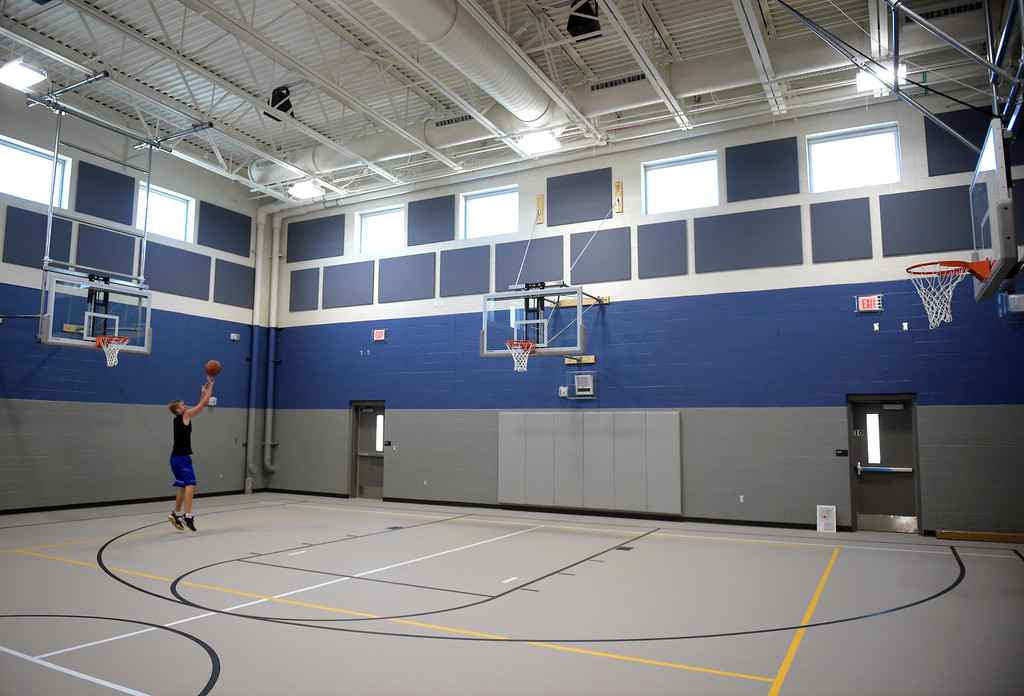 . Alex Sturn shoots baskets in the gymnasium at Grand View Elementary School, 6601 Aggregate Blvd., Frederick, Tuesday. To view more photos visit timescall.com. Lewis Geyer/Staff Photographer July 10, 2018