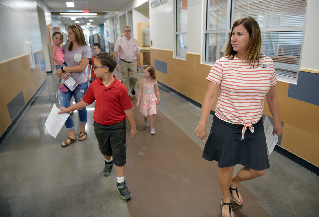 . Fourth grader Walter Delgado and fourth grade teacher Jennifer Ranweiler give a tour of Grand View Elementary School, 6601 Aggregate Blvd., Frederick, Tuesday. To view more photos visit timescall.com. Lewis Geyer/Staff Photographer July 10, 2018