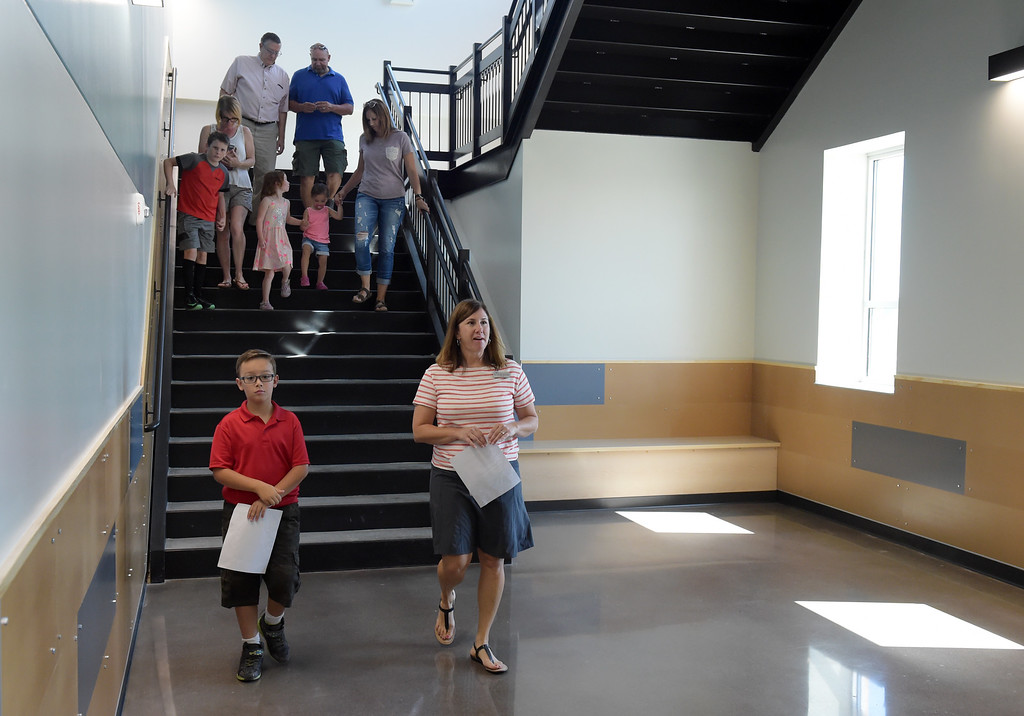 . Fourth grader Walter Delgado and fourth grade teacher Jennifer Ranweiler wrap up a tour of Grand View Elementary School, 6601 Aggregate Blvd., Frederick, Tuesday. To view more photos visit timescall.com. Lewis Geyer/Staff Photographer July 10, 2018