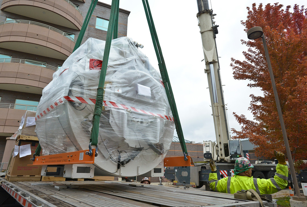 . LONGMONT, CO - OCTOBER 11: A new MRI machine is lifted over the roof of Longmont United Hospital Oct. 11, 2018 for its installation. The 11,500 pound unit is expected to be up and running by the middle of November. (Photo by Lewis Geyer/Staff Photographer)