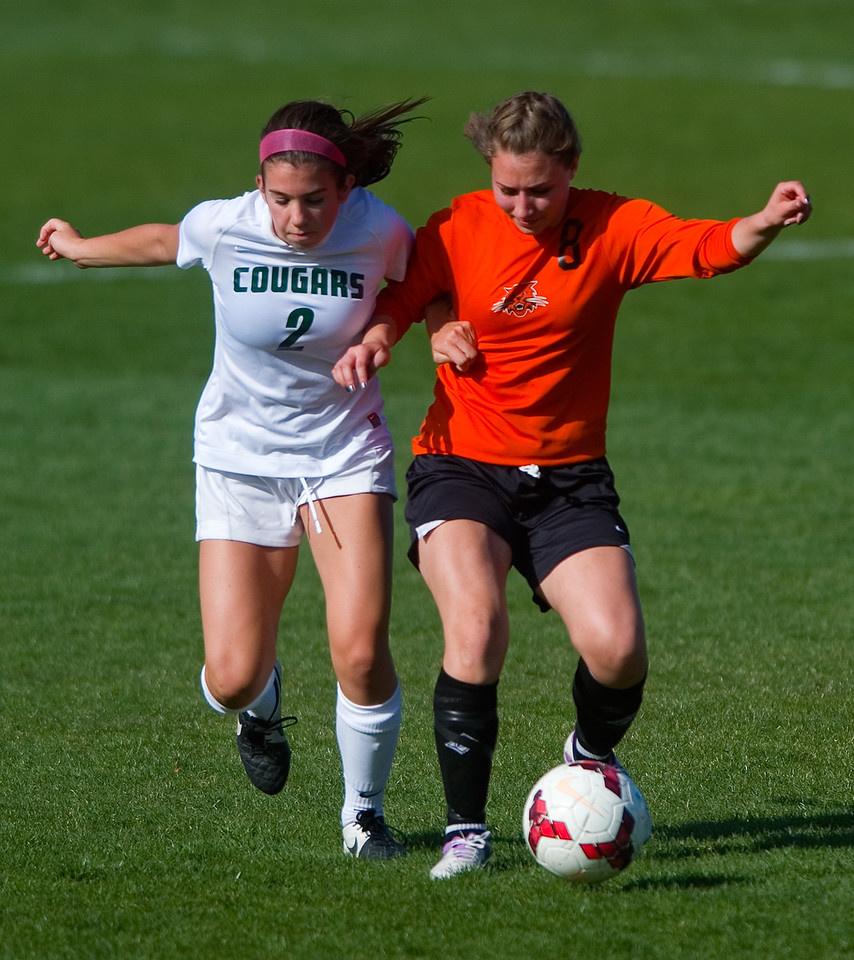 "Greeley's Reina Sotelo and Niwot's Anna McCarthy both go after the ball during the game at Niwot High School on Friday evening. More photos:  <a href=""http://www.BoCoPreps.com"">http://www.BoCoPreps.com</a> Autumn Parry/Staff Photographer<br /> April 22, 2016"