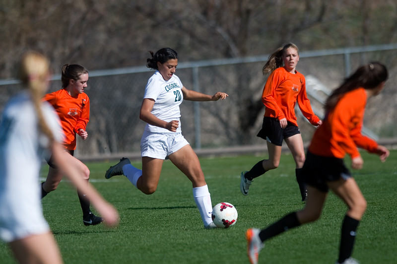 "Niwot's Nazary Ramirez passes the ball to a teammate while surronded by Greeley's defense during the game at Niwot High School on Friday evening. More photos:  <a href=""http://www.BoCoPreps.com"">http://www.BoCoPreps.com</a> Autumn Parry/Staff Photographer<br /> April 22, 2016"