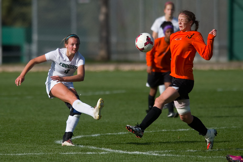 "Niwot's Maddie Barkow kicks the ball past Greeley's Alexis Bradfield during the game at Niwot High School on Friday evening. More photos:  <a href=""http://www.BoCoPreps.com"">http://www.BoCoPreps.com</a> Autumn Parry/Staff Photographer<br /> April 22, 2016"