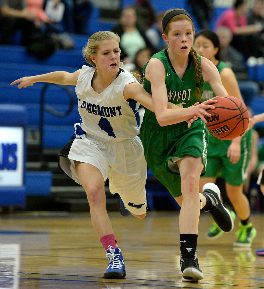Longmont's Sam Wiley reaches in on Niwot's Mary Gillett in the first quarter Friday night at Longmont High School. <br /> Lewis Geyer/Staff Photographer<br /> Feb. 05, 2016<br /> To view more photos visit bocopreps.com