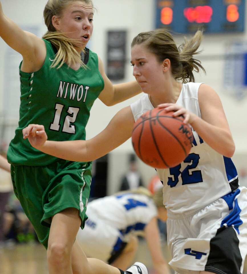 Longmont's Kennedy Sheetz is covered by Niwot's Rosie Setter Friday night at Longmont High School. Longmont beat Niwot 35-19.<br /> Lewis Geyer/Staff Photographer<br /> Feb. 05, 2016<br /> To view more photos visit bocopreps.com
