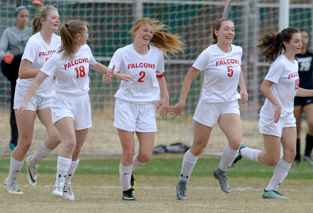 . Skyline\'s Sabrina Bridwell, 2, is congratulated by teammates after scoring in the second half against Niwot Tuesday at Skyline High School. Lewis Geyer/Staff Photographer March 21, 2017