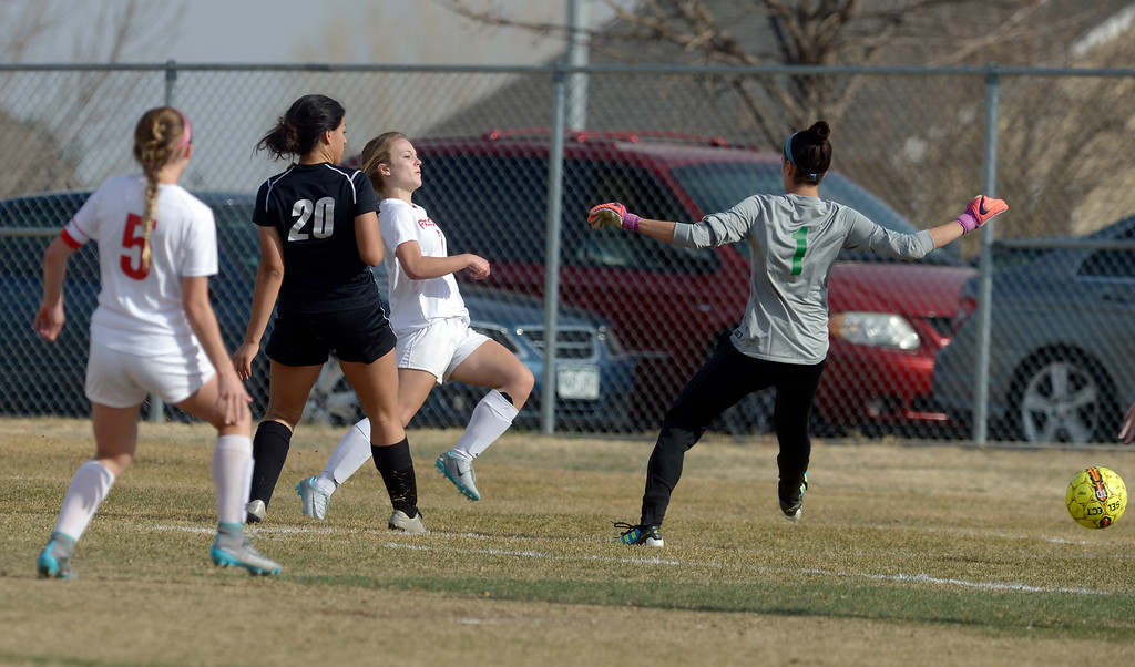 . Skyline\'s Whitney Parkinson kicks the ball past Niwot goalkeeper Alexandra Colvin to score a goal in the first half Tuesday at Skyline High School. Lewis Geyer/Staff Photographer March 21, 2017