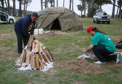 Yurok Jeff Guido of McKinleyville, left, and Garrett Wild of Weitchpec get prepare to start the fire for a sweat lodge at the North Coast Stand Down at the Humboldt County Fairgrounds in Ferndale on Friday. The annual three-day event provides a variety of services to all veterans and their families. It continues today from 9 a.m. to 6 p.m. and Sunday from 9 a.m. to noon. For more information, go to northcoaststanddown.org. (Shaun Walker -- The Times-Standard)