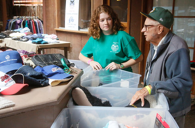 Volunteer Meghan Lang of Arcata helps veteran John Eyeler of Eureka look for clothing at the North Coast Stand Down at the Humboldt County Fairgrounds in Ferndale on Friday. The annual three-day event provides a variety of services to all veterans and their families. It continues today from 9 a.m. to 6 p.m. and Sunday from 9 a.m. to noon. For more information, go to northcoaststanddown.org. (Shaun Walker -- The Times-Standard)