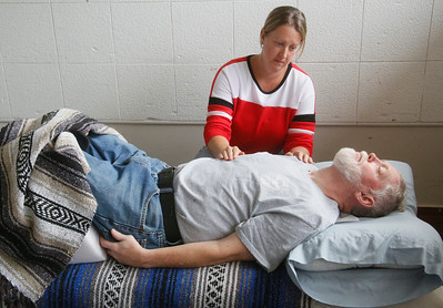 Veteran Bill Stoltz of Fortuna gets a reiki session from Kimberly Jurgemeyer of Eureka at the North Coast Stand Down at the Humboldt County Fairgrounds in Ferndale on Friday. The annual three-day event provides a variety of services to all veterans and their families. It continues today from 9 a.m. to 6 p.m. and Sunday from 9 a.m. to noon. For more information, go to northcoaststanddown.org. (Shaun Walker -- The Times-Standard)