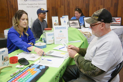 Veteran Tom Pye of Weitchpec, right, chats with Lisa Leon of Tri-County Independent Living at the North Coast Stand Down at the Humboldt County Fairgrounds in Ferndale on Friday. The annual three-day event provides a variety of services to all veterans and their families. It continues today from 9 a.m. to 6 p.m. and Sunday from 9 a.m. to noon. For more information, go to northcoaststanddown.org. (Shaun Walker -- The Times-Standard)