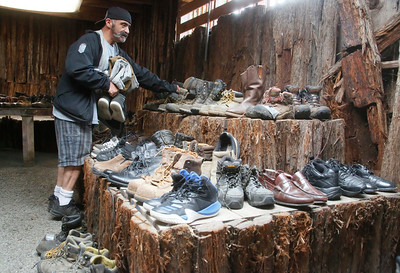 Fermin Salas of Eureka looks at boots at the North Coast Stand Down at the Humboldt County Fairgrounds in Ferndale on Friday. The annual three-day event provides a variety of services to all veterans and their families. It continues today from 9 a.m. to 6 p.m. and Sunday from 9 a.m. to noon. For more information, go to northcoaststanddown.org. (Shaun Walker -- The Times-Standard)