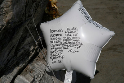 A makeshift memorial to 19-year-old HSU freshman KeyMaan Stringer, who was swept off the rocks on Monday, sits near the North Jetty area where he was last seen on Thursday. (Shaun Walker -- The Times-Standard)