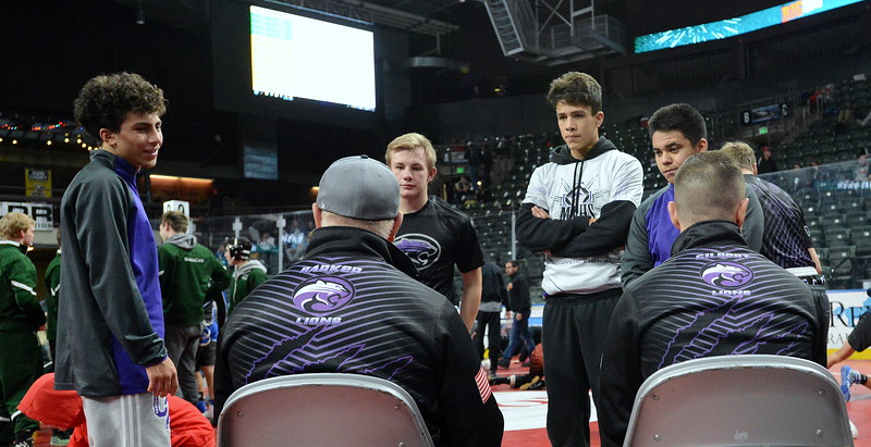 Mountain View coaches Scott Barker (left) and John Gilbert chat with their team prior to the start of Friday's action at the Northern Colorado Christmas Tournament at the Budweiser Events Center. (Mike Brohard/Loveland Reporter-Herald)