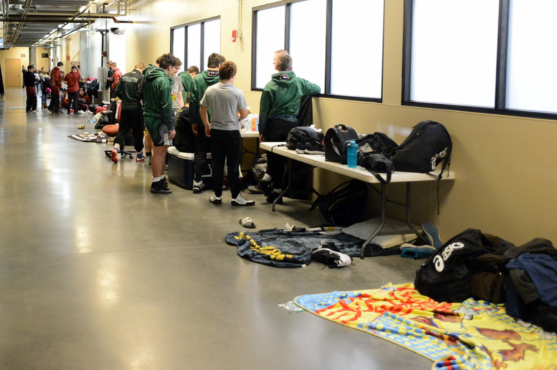 With 64 teams in attendance for the Northern Colorado Christmas Tournament, wrestlers spread out and clained spaces at the Budweiser Events Center for their teams to rest, nap, study and relax over the course of the two-day event. (Mike Brohard/Loveland Reporter-Herald)