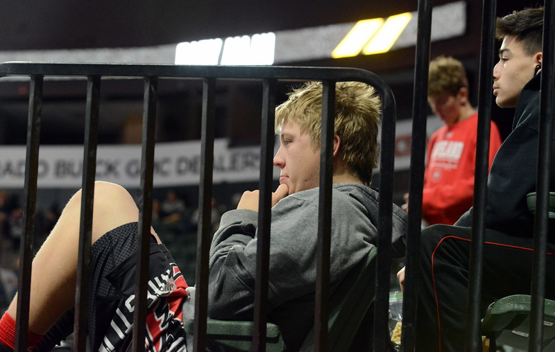 Loveland's Cory Dargatz tries to get comfortable in the seats at the Budweiser Events Center as he waits out a first-round bye at the Northern Colorado Christmas Tournament on Friday. (Mike Brohard/Loveland Reporter-Herald)