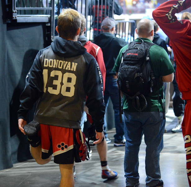 Loveland's Cody Donovan stretches out in the tunnel, keeping an eye on the mats Friday during the Northern Colorado Christmas Tournament at the Budweiser Events Center. (Mike Brohard/Loveland Reporter-Herald)