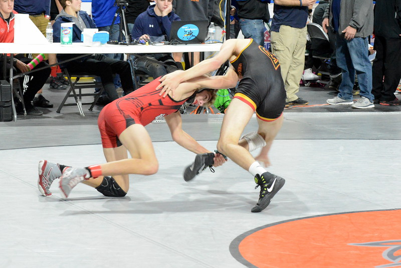 Loveland 132-pounder Jude Quinlan grabs the heel of Castle View's Adrian Gonzales on his way to a takedown in their first-round match of the Northern Colorado Christmas Tournament at the Budweiser Events Center. Quinlan won a 9-4 decision. (Mike Brohard/Loveland Reporter-Herald)
