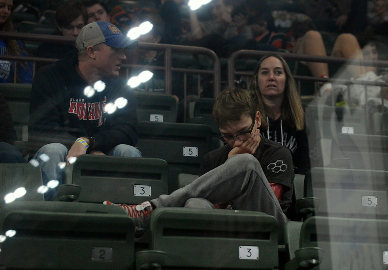Loveland wrestler Cody Thompson looks at his phone as passes the time Friday at the Northern Colorado Christmas Tournament at the Budweiser Events Center. Thompson had a first-round bye. (Mike Brohard/Loveland Reporter-Herald)