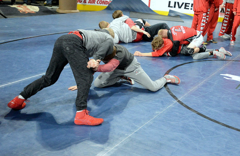 Loveland wrestlers warm up prior to Friday's start of the Northern Colorado Christmas Tournament at the Budweiser Events Center. (Mike Brohard/Loveland Reporter-Herald)