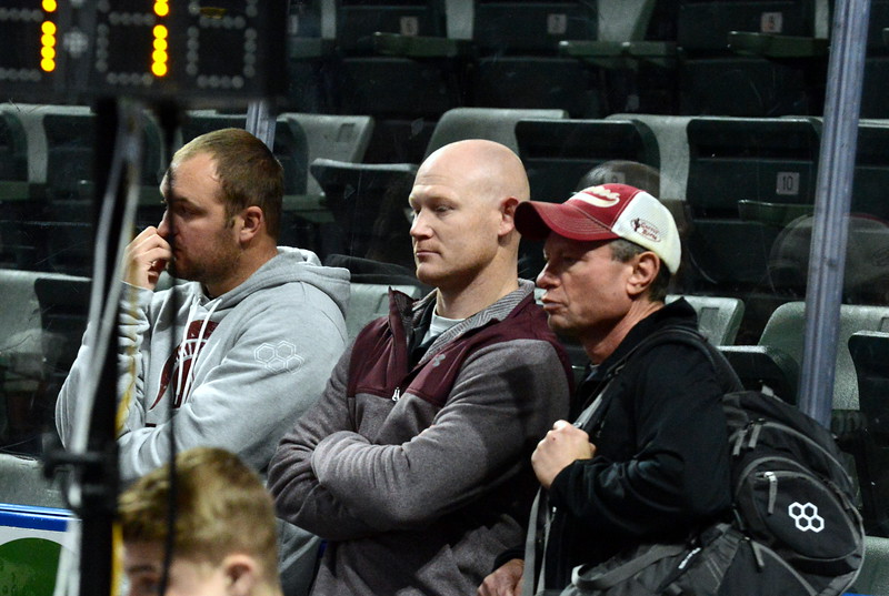 Berthoud coaches Robby Workman (left), Will Carron (middle) and Faren Stroh watch a match as they wait for Dalton Williams' turn in Friday's first round of the Northern Colorado Christmas Tournament at the Budweiser Events Center. (Mike Brohard/Loveland Reporter-Herald)