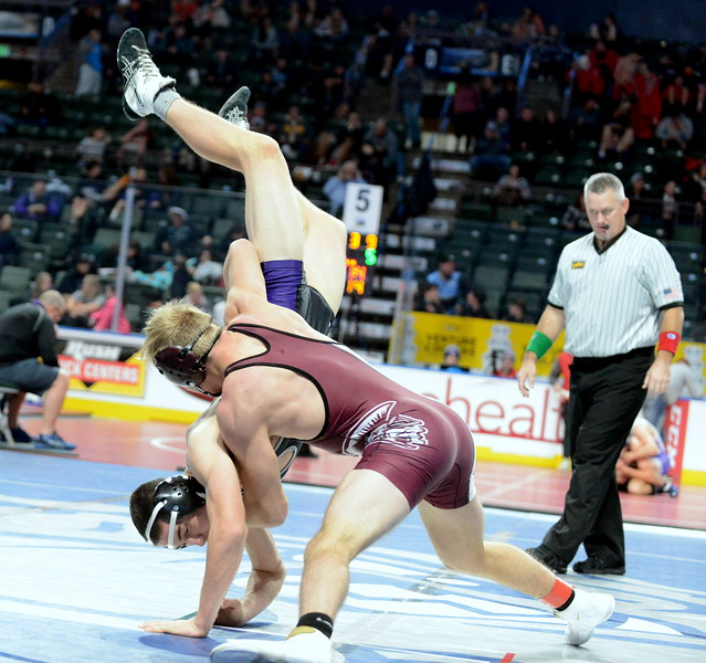 Berthoud's Austyn Binkly throws Dylan Ruane of Discovery Canyon to the mat, a move that led directly to a pin in :57 of their  145-pound match Friday in the second round of the Northern Colorado Christmas Tournament at the Budweiser Events Center. (Mike Brohard/Loveland Reporter-Herald)