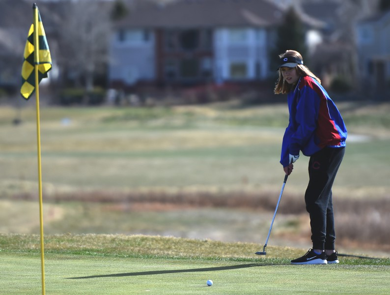 Centaurus golfer Molly Grant watches a putt roll towards the pin during the Northern League golf tournament on Tuesday, April 3, at Ute Creek Golf Course in Longmont.
