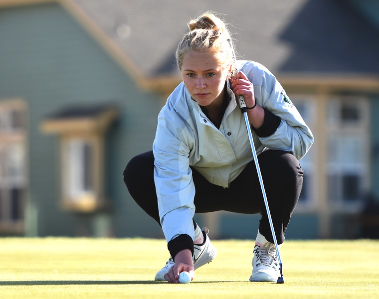 Niwot's Julia Solem lines up a putt on No. 17 during the Northern League golf tournament on Tuesday, April 3, at Ute Creek Golf Course in Longmont.