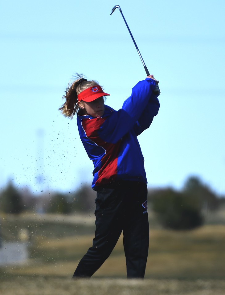 Centaurus golfer Julia Mischke tees off during the Northern League golf tournament on Tuesday, April 3, at Ute Creek Golf Course in Longmont.