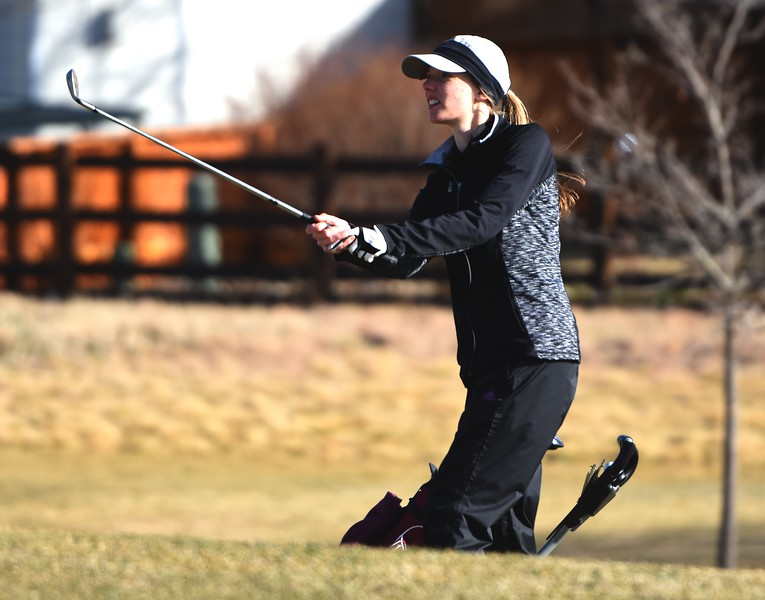 Silver Creek's Taylor Sandal chips on No. 17 during the Northern League golf tournament on Tuesday, April 3, at Ute Creek Golf Course in Longmont.