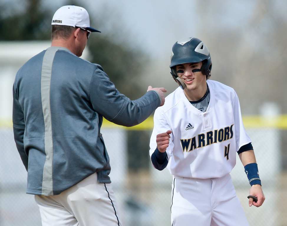 . FREDERICK, CO - MARCH 22: Frederick\'s Trevor Hazlett is congratulated for his triple in the first inning against Northridge at Frederick High School March 22, 2019. To view more photos visit bocopreps.com. (Photo by Lewis Geyer/Staff Photographer)
