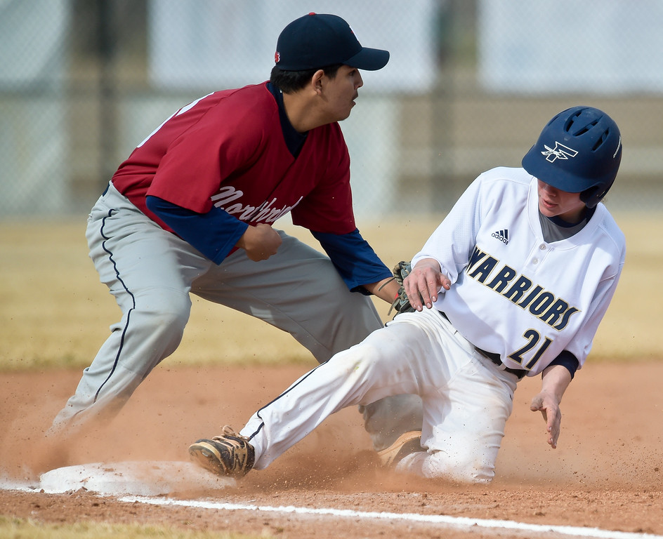 . FREDERICK, CO - MARCH 22: Frederick\'s Cole Hoffman is safe at third next to Northridge\'s Ricardo Sanchez in the first inning at Frederick High School March 22, 2019. To view more photos visit bocopreps.com.(Photo by Lewis Geyer/Staff Photographer)
