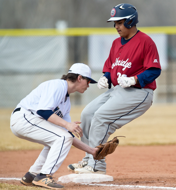 . FREDERICK, CO - MARCH 22: Northridge\'s Louie Ramirez is safe at third in front of Frederick\'s Cole Hoffman in the second inning at Frederick High School March 22, 2019. To view more photos visit bocopreps.com. (Photo by Lewis Geyer/Staff Photographer)