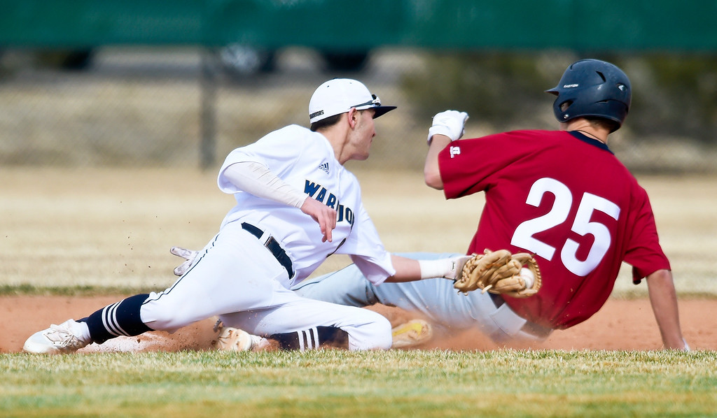 . FREDERICK, CO - MARCH 22: Northridge\'s Joe Lombardelli slides past Frederick\'s Jonah Sanders in the first inning against Northridge at Frederick High School March 22, 2019. To view more photos visit bocopreps.com. (Photo by Lewis Geyer/Staff Photographer)