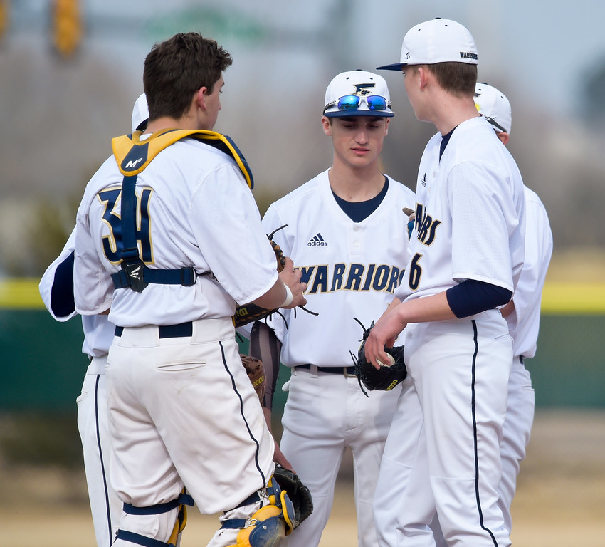 . FREDERICK, CO - MARCH 22: Frederick meets on the mound during a timeout in the second inning against Northridge at Frederick High School March 22, 2019. To view more photos visit bocopreps.com. (Photo by Lewis Geyer/Staff Photographer)