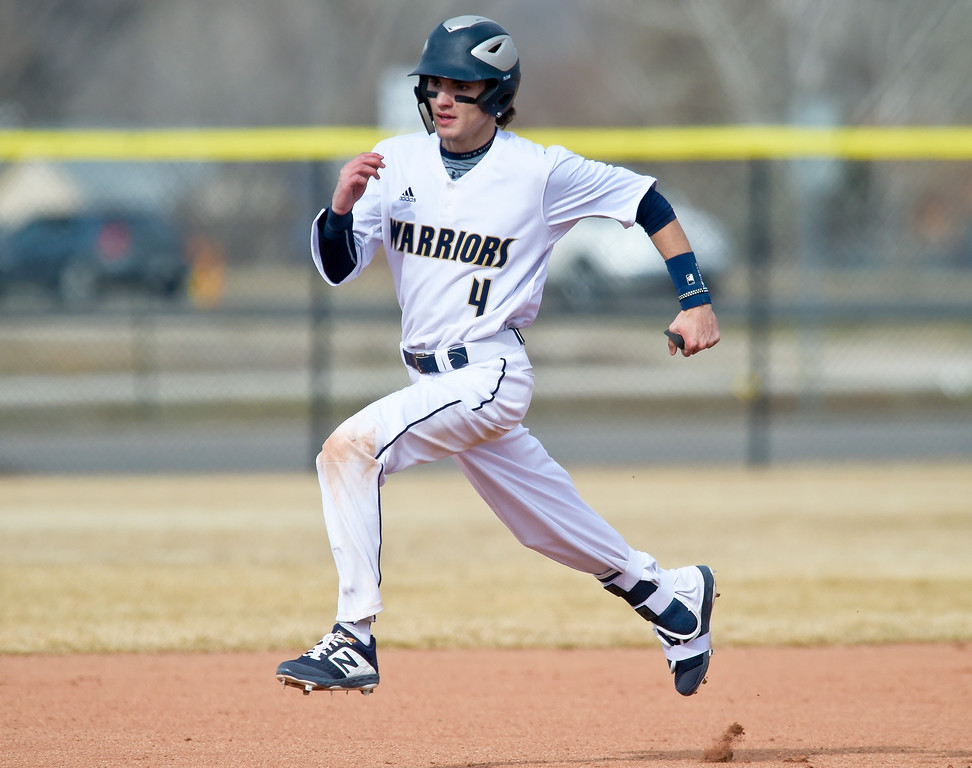 . FREDERICK, CO - MARCH 22: Frederick\'s Trevor Hazlett heads to third on his triple in the first inning against Northridge at Frederick High School March 22, 2019. To view more photos visit bocopreps.com.(Photo by Lewis Geyer/Staff Photographer)