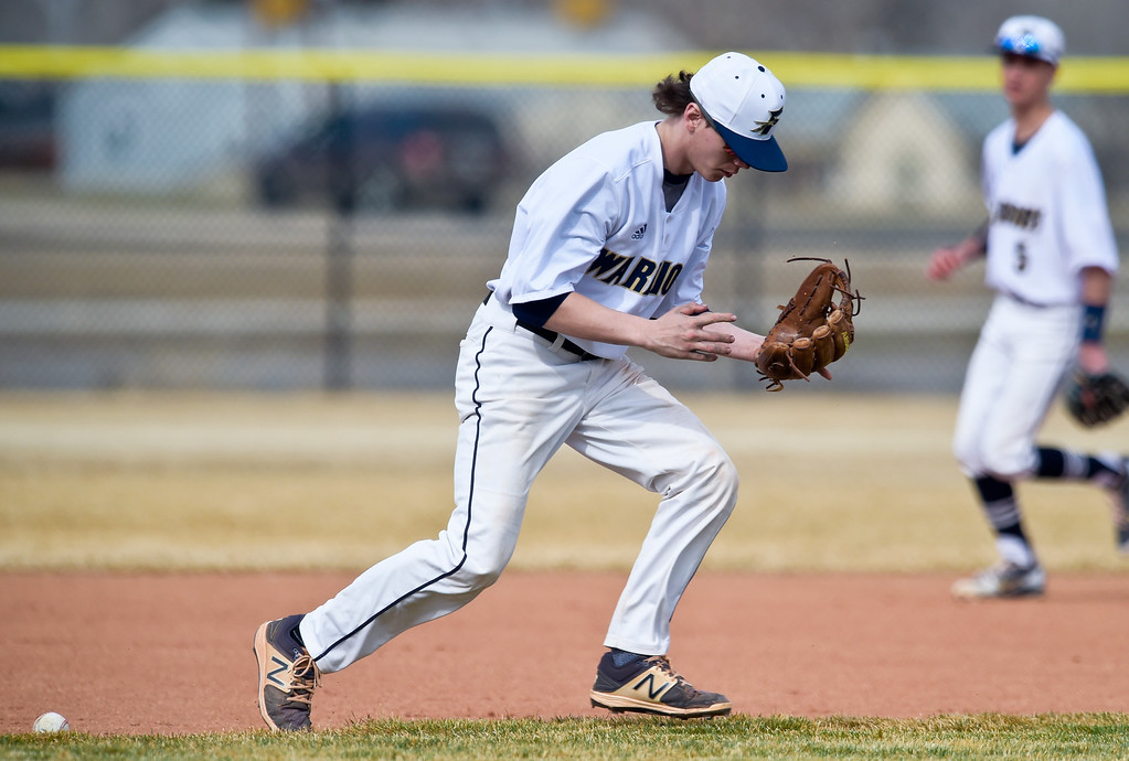 . FREDERICK, CO - MARCH 22: The ball gets past Frederick\'s Cole Hoffman at third base in the first inning against Northridge at Frederick High School March 22, 2019. To view more photos visit bocopreps.com. (Photo by Lewis Geyer/Staff Photographer)
