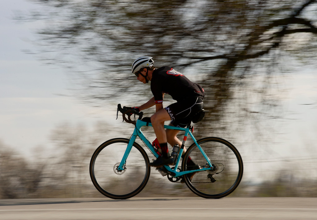 . A cyclist on Colo. 66 passes the entrance to a property owned by Martin Marietta Materials near Lyons on Wednesday. More photos: DailyCamera.com. Matthew Jonas/Staff Photographer March 22,  2017