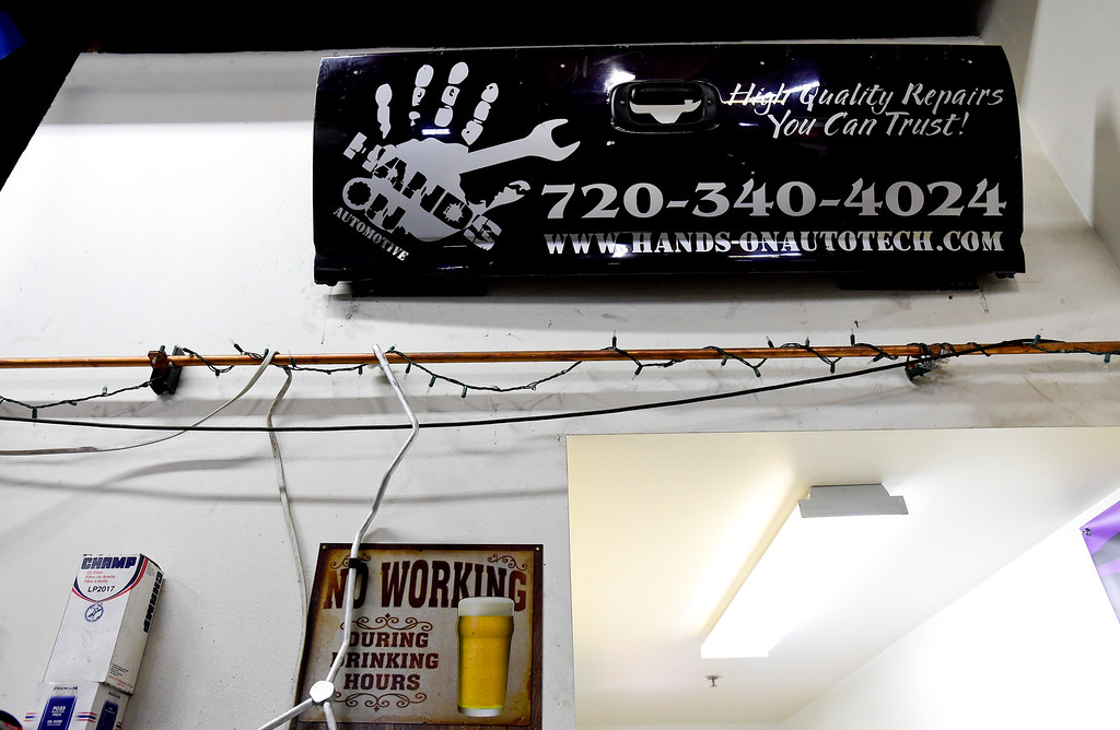 ". LONGMONT, CO - FEBRUARY 4:The tailgate of Tom Maggio\'s truck is seen hanging on the wall at Hands-On Auto Tech. near Longmont on Feb. 4, 2019. Maggio crashed into a tractor trailer on November 27th, 2018, and as a result of his injuries, had to have his leg amputated. ""It was the only straight piece left,\"" said Technician Tim Holt.  (Photo by Matthew Jonas/Staff Photographer)"