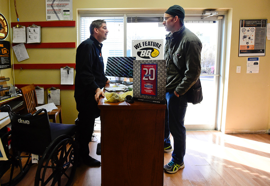 . LONGMONT, CO - FEBRUARY 4:Tom Maggio, left, talks with customer Evan Lechelt, currently staying in Firestone, right, at Hands-On Auto Tech. near Longmont on Feb. 4, 2019. Maggio crashed into a tractor trailer on November 27th, 2018, and as a result of his injuries, had to have his leg amputated. (Photo by Matthew Jonas/Staff Photographer)
